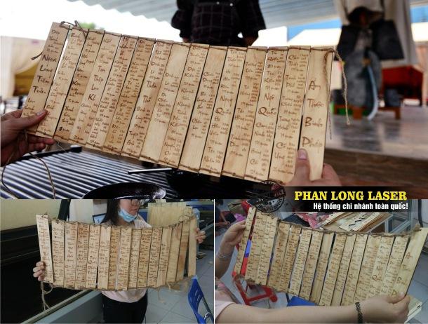 Thiết kế menu bìa gỗ cho quán ăn Tam Quốc Cổ trang tại Quận Bình Thạnh